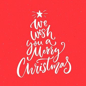 Wij wensen u een vrolijk kerstfeest. kalligrafietekst voor wenskaarten op rode achtergrond. Premium Vector