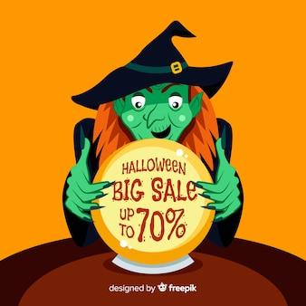 Wijfje dat een verkoop van halloween van de heksenbal onderzoekt