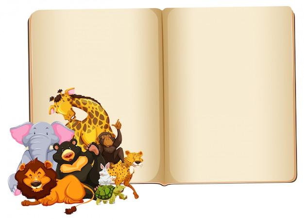 Wild dier op blanco boek met copyspace
