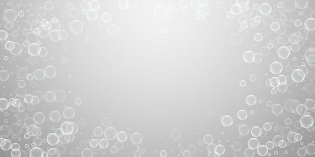 Willekeurige zeepbellen abstracte achtergrond. bellen blazen op lichtgrijze achtergrond. verbazingwekkende overlay-sjabloon van zeepachtig schuim. interessante vectorillustratie.