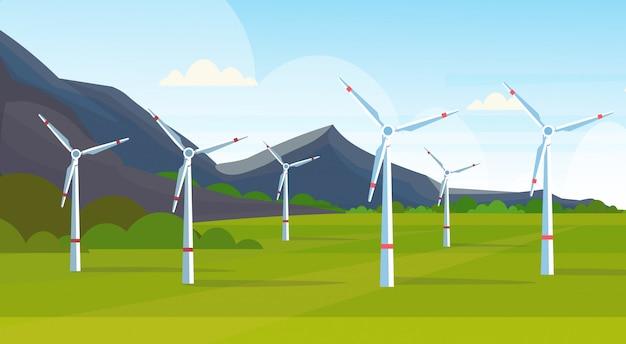 Windturbines veld schone alternatieve energiebron hernieuwbaar station concept natuurlijk landschap bergen achtergrond horizontaal