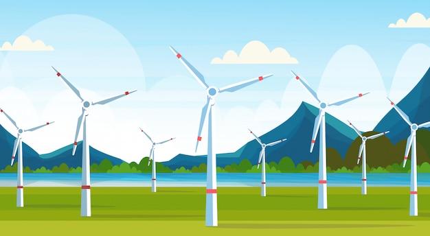 Windturbines veld schone alternatieve energiebron hernieuwbare station concept natuurlijk landschap rivier bergen achtergrond horizontaal