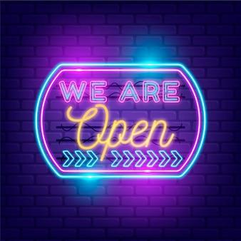 Winkel met we zijn open teken in neonlichten