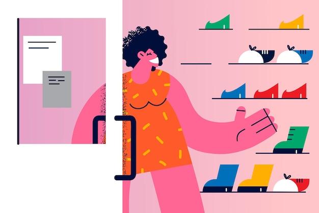 Winkelen en schoenen concept kiezen. jonge glimlachende vrouwelijke stripfiguur die schoenenwinkel binnenkomt voor een nieuw paar schoenen of laarzen vectorillustratie