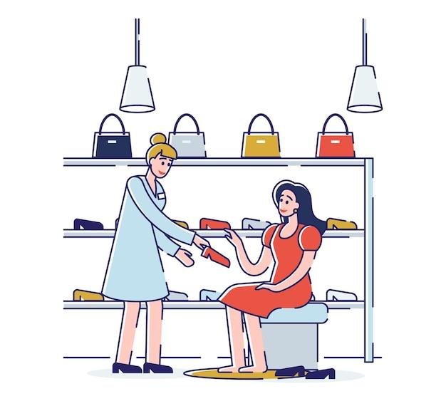 Winkelen in schoenenwinkel winkelbediende helpt bij het kiezen en passen van schoenen aan de vrouw