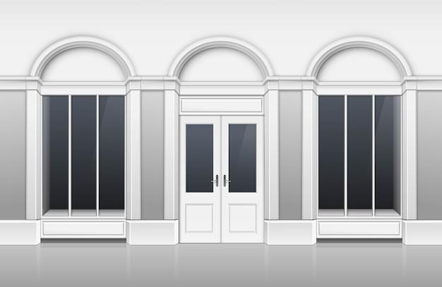 Winkelgebouw met glazen vitrine, gesloten deur