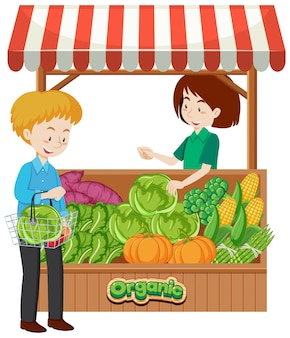 Winkelier en klant bij groentenverkoper