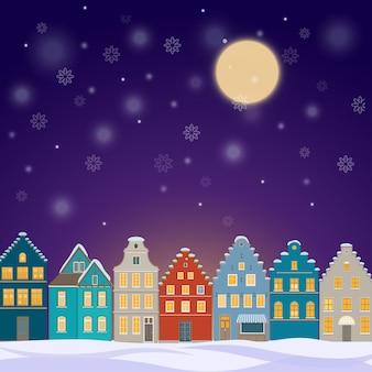 Winter achtergrond met oude stad 's nachts