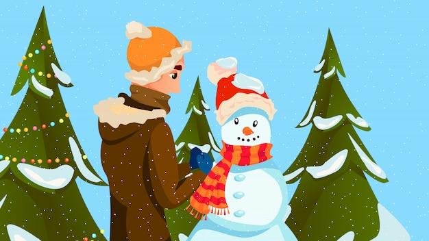 Winter fun man bouw sneeuwpop maak wortelneus