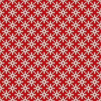 Winter vakantie naadloos gebreide patroon met een sneeuwvlokken. kerst breien trui design. wol gebreide textuur