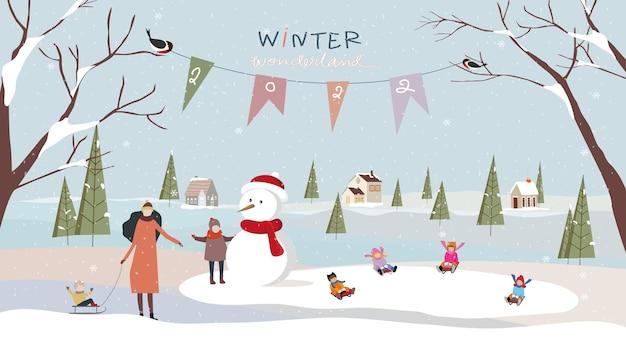 Winter wonderland landschap achtergrond met viering van mensen en kinderen die plezier hebben in het park