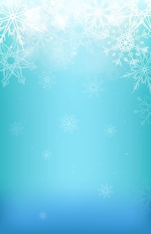 Winterachtergrond met sneeuwvlokken, glitters en onscherpe achtergrond