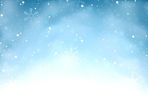 Winterkerstachtergrond van sneeuw en vlokken op blauw