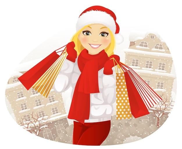 Winters shoppen. gelukkig meisje met boodschappentassen op winter straat.