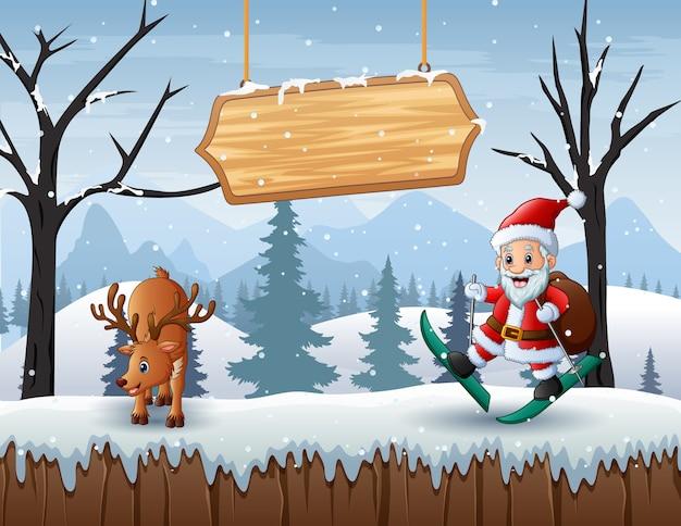 Winters tafereel met de kerstman en een hert in de sneeuw