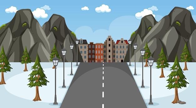 Winters tafereel met lange weg door het park naar de stad