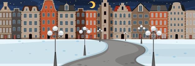 Winterseizoen met weg door het park naar de stad bij nachtelijke horizontale scène