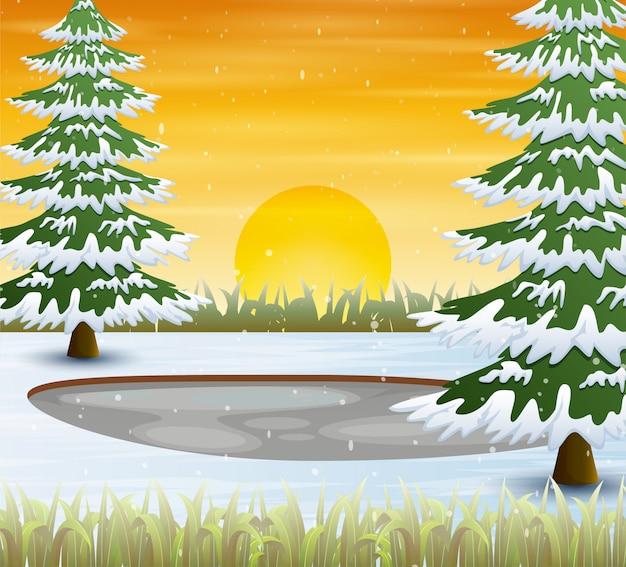 Wintertijd met sneeuw behandelde bomen bij zonsondergangscène