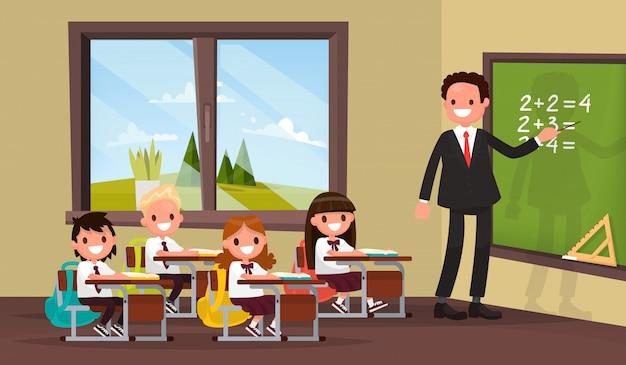 Wiskunde les. een leraar met leerlingen in het basisonderwijs.