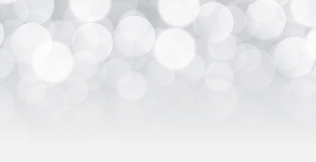 Wit bokehontwerp als achtergrond met tekstruimte