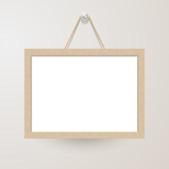 Wit bord met touw opknoping op een spijker