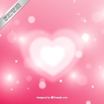 Wit hart op roze bokeh achtergrond