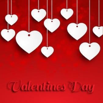Wit papier opknoping harten op rode achtergrond
