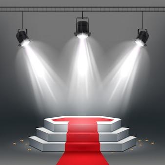 Wit podium en rode loper verlicht door schijnwerpers