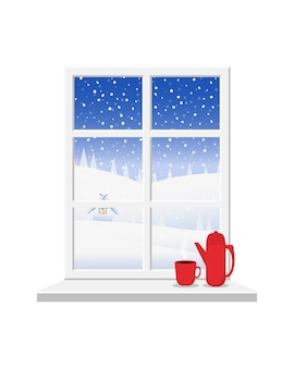 Wit raam met uitzicht op het winterlandschap.