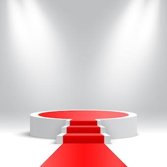 Wit rond podium met trappen en rode loper leeg voetstuk met treden en schijnwerpers
