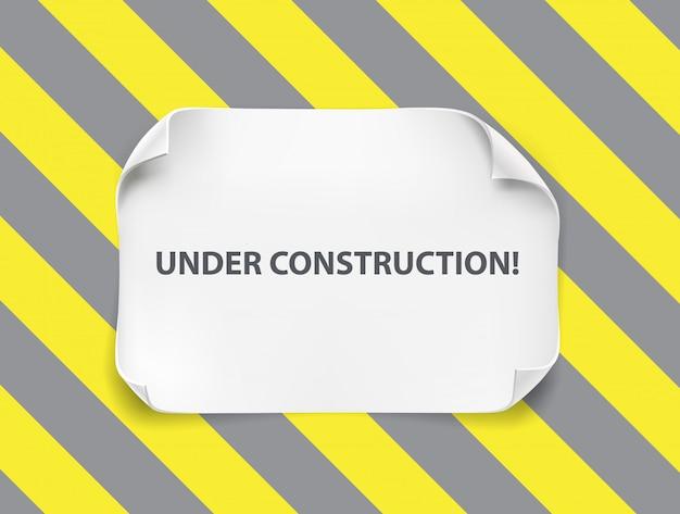 Witboek blad met gebogen hoeken op constructie banner.