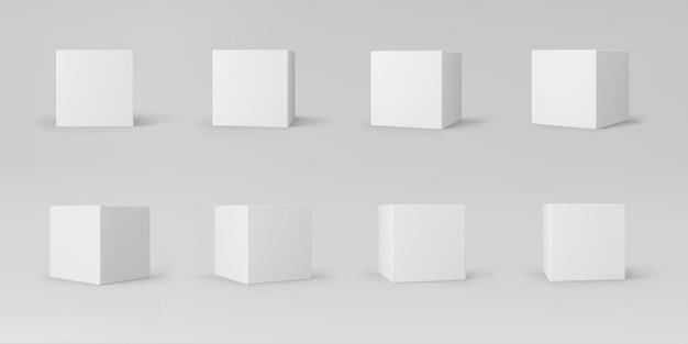 Witte 3d kubussen die met geïsoleerd perspectief worden geplaatst