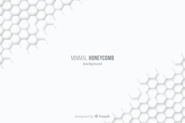 Witte achtergrond met opgebouwde honingraten op hoeken