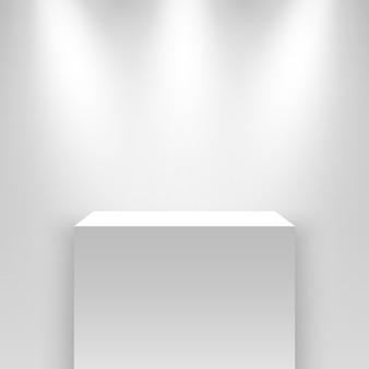 Witte beursstand, verlicht door schijnwerpers. voetstuk.