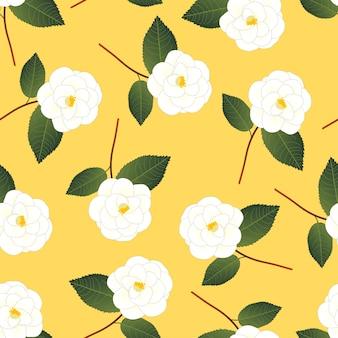 Witte camellia-bloem op gele achtergrond
