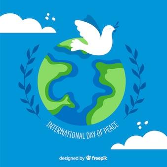 Witte duif op aarde voor vredesdag