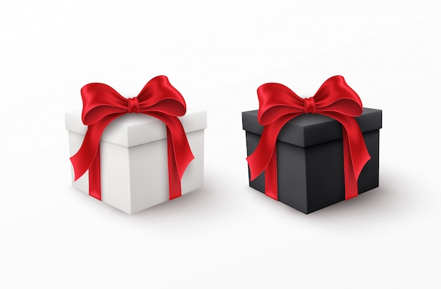 Witte en zwarte geschenkdozen met rode zijden bogen geïsoleerd