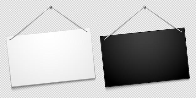 Witte en zwarte uithangborden van winkeldeur die op spijker hangen die op transparant wordt geïsoleerd