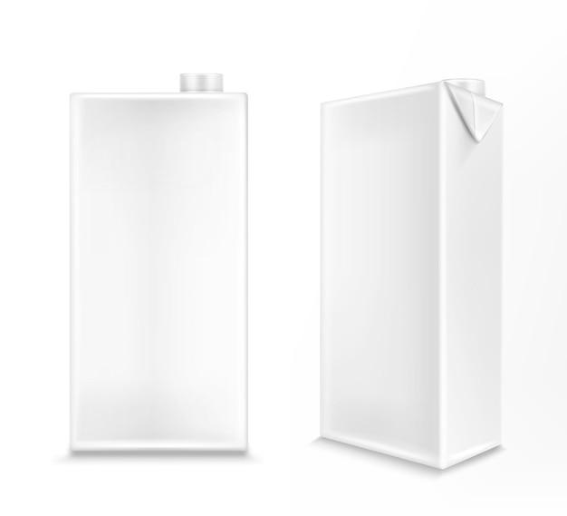 Witte kartonnen doos voor melk of sap aan de voorkant en vanuit de hoek