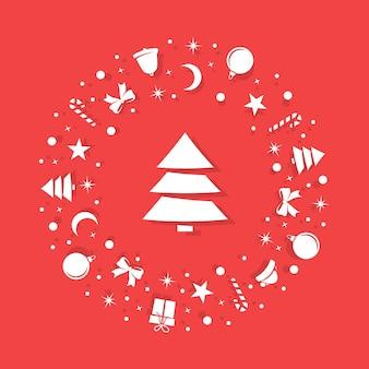 Witte kerstsymbolen zijn willekeurig gerangschikt op een rode achtergrond in de vorm van een cirkel.