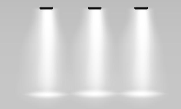 Witte lege indoor beursstand voor presentatie met spotlight op de grijze achtergrond. witte lege promotionele 3d-beursstand. scene show podium voor presentaties. .