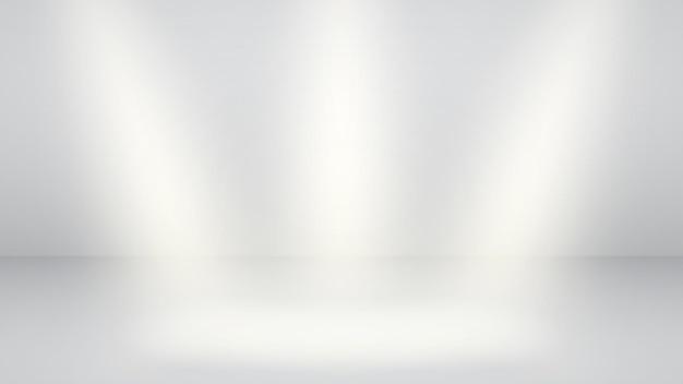 Witte lege studioachtergrond met drie stralen van licht