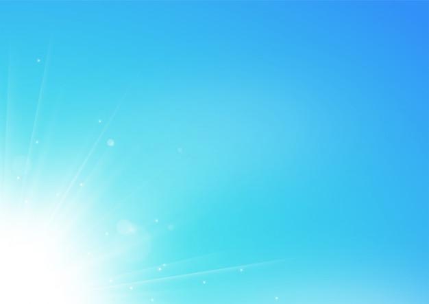 Witte lichtstralen die op blauwe hemel achtergrond schijnen