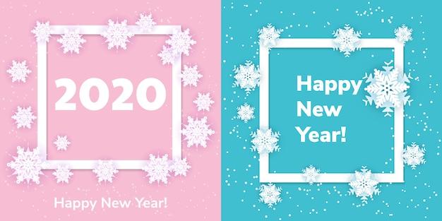Witte origamisneeuwvlokken met schaduw op blauw en roze. papier gesneden. vierkant kader instellen. winter illustratie voor het versieren van het nieuwe jaar 2020 en kerstmis.