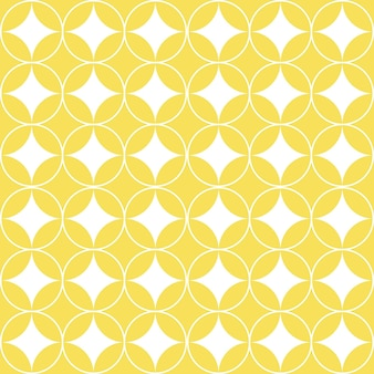 Witte overlappende cirkels op gele geometrische naadloze patroon.
