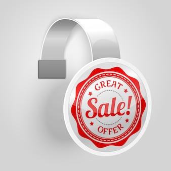 Witte plastic wobbler met rood verkooplabel.