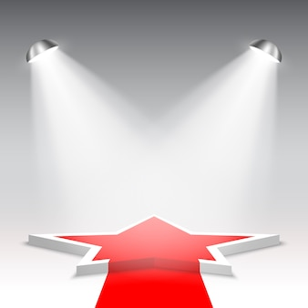 Witte podium met rode loper. voetstuk. ster. podium voor prijsuitreiking. vijfhoekige scène met schijnwerpers. .