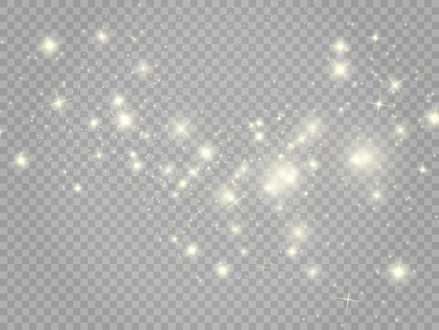 Witte vonken en gouden sterren schitteren speciaal lichteffect op transparante achtergrond.
