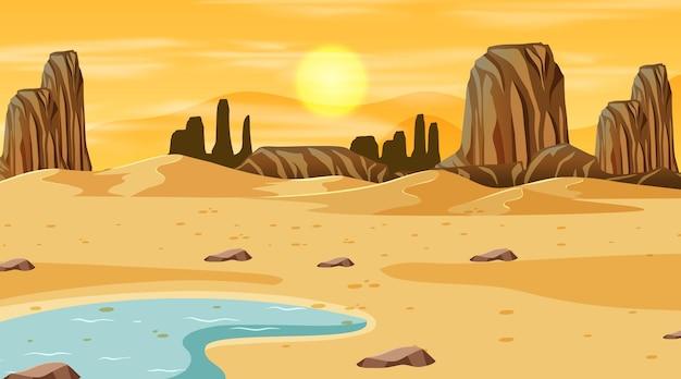 Woestijnboslandschap bij zonsondergangtijdscène met oasis