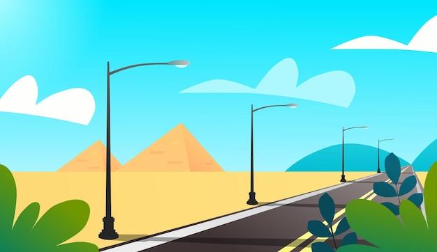 Woestijnweg met straatlantaarn en prachtig landschap premium vector